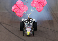 Feb 22, 2014; Chandler, AZ, USA; NHRA jet dragster lifts his front wheels off the ground at the hit of the parachutes during qualifying for the Carquest Auto Parts Nationals at Wild Horse Pass Motorsports Park. Mandatory Credit: Mark J. Rebilas-USA TODAY Sports
