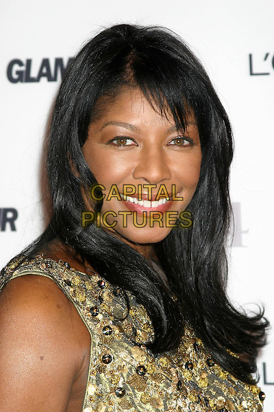 NATALIE COLE.15th Annual GLAMOUR Women of the Year Awards . American Museum of Natural History.New York City, New York, USA,.8th November 2004..portrait headshot.Ref: IW.www.capitalpictures.com.sales@capitalpictures.com.©Capital Pictures.