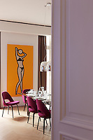 "A large painting by Julian Opie entitled ""This is Monique 31"" can be seen through the open door leading to the dining room"