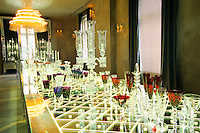The shop and showroom at the Baccarat museum, shop, restaurant at the Hotel de Noailles in Paris. Crystal chandeliers and glasses. Designed by Philippe Starck. The Baccarat shop with its revolving crystal chandelier