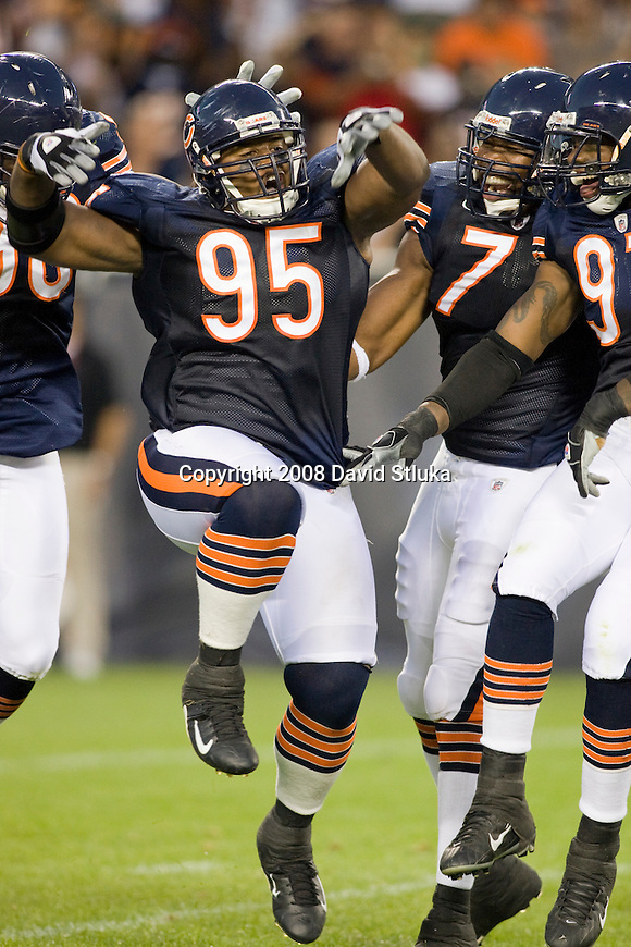 CHICAGO - AUGUST 7: Defensive tackle Anthony Adams #95 of the Chicago Bears celebrates a quarterback sack with his teammates against the Kansas City Chiefs at Soldier Field on August 7, 2008 in Chicago, Illinois. The Chiefs defeated the Bears 24-20. (AP Photo/David Stluka)