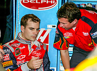 Jeff Gordon, Robbie Loomis, UAW-GM Quality 500, Charlotte Motor Speedway, Charlotte, NC, October 11, 2003.  (Photo by Brian Cleary/bcpix.com)