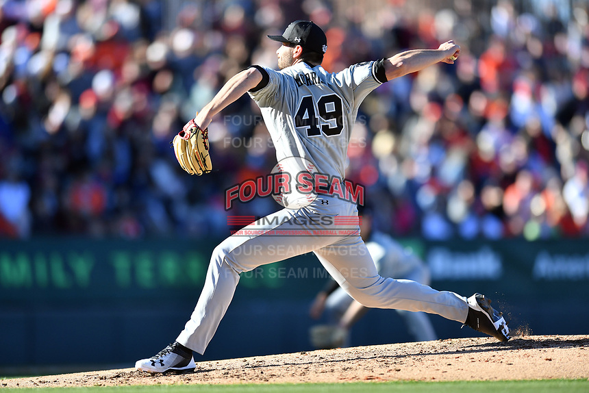 South Carolina Gamecocks starting pitcher Cody Morris (49) delivers a pitch during a game against the Clemson Tigers at Fluor Field on March 3, 2018 in Greenville, South Carolina. The Tigers defeated the Gamecocks 5-1. (Tony Farlow/Four Seam Images)
