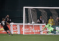 Charlie Davies (9) of D.C. United beats Donovan Ricketts (1) of the Los Angeles Galaxy from the penalty spot for the tying goal during an MLS match at RFK Stadium, on April 9 2011, in Washington D.C.The game ended in a 1-1 tie.