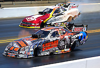 Jul. 27, 2014; Sonoma, CA, USA; NHRA funny car driver Matt Hagan (near lane) races alongside Tim Wilkerson during the Sonoma Nationals at Sonoma Raceway. Mandatory Credit: Mark J. Rebilas-