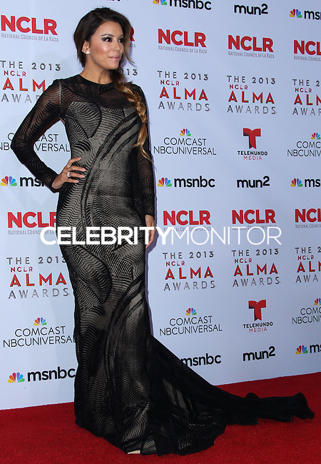 PASADENA, CA - SEPTEMBER 27: Actress Eva Longoria poses in the press room during the 2013 NCLR ALMA Awards held at Pasadena Civic Auditorium on September 27, 2013 in Pasadena, California. (Photo by Xavier Collin/Celebrity Monitor)