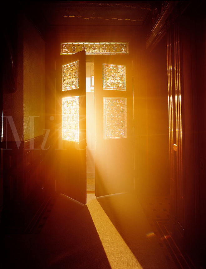 Golden light streaming through open door.