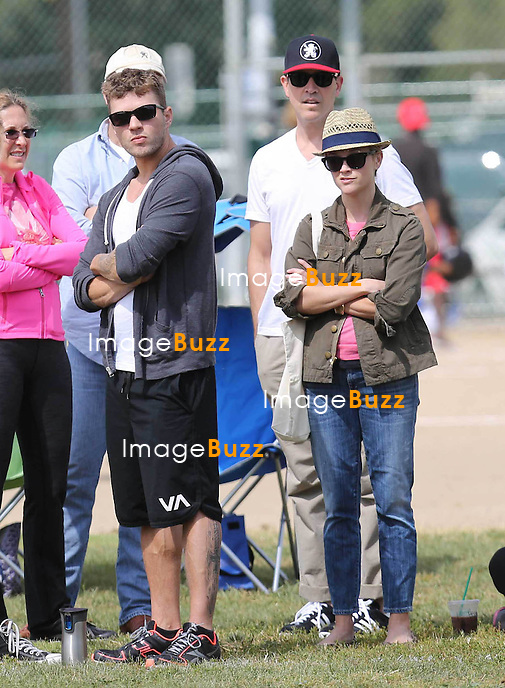 Reese Witherspoon is casual cute while heading to her son Deacon's football game in Los Angeles with her husband Jim Toth  and ex husband Ryan Phillippe, on Saturday May 18, 2013..