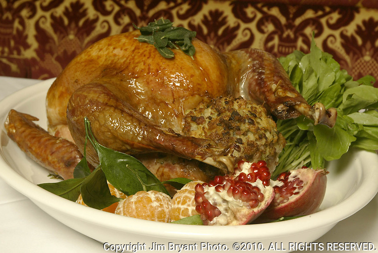 Hunt Club Restaurant Chef Brian Scheehser's 15-pound turkey stuffed with sage and sausage stuffing.  On the left is baked winter squash with pomegranet seeds and ,right is cranberries tossed with sugar and cinnamon. Jim Bryant Photo. ©2010. All Rights Reserved.