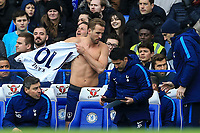 Harry Kane of Spurs prepares to come on the pitch after his injury layoff during the Premier League match between Chelsea and Tottenham Hotspur at Stamford Bridge, London, England on 1 April 2018. Photo by Andy Rowland.