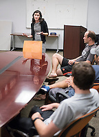Sara Semal, Senior Director of Student Wellness Services and Marianne Frapwell, Project S.A.F.E. Program Manager and Survivor Advocate, meet with coaches in the Athletics Department on Oct. 9, 2015. They met to discuss a collaboration between Athletics and Project S.A.F.E. (Sexual Assault Free-Environment), a prevention, education, and advocacy program dedicated to addressing issues of sexual assault on campus.<br />
