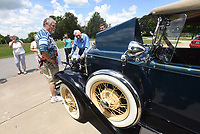 NWA Democrat-Gazette/FLIP PUTTHOFF<br />BIRTHDAY RIDE<br />Ryland Whitaeker (cq), 98, of Tontitown (center) looks over a 1931 Ford Model A Roadster Deluxe before taking a ride in the car Saturday July 15 2017 for his 98th birthday, courtesy of the car's owner, James Stewart (left) of Benton. Whitaeker's great grandson, Logan Hood (right), arranged the birthday ride in part because Whitaeker owned his own Model A that he purchased in 1937 for $65. Whitaeker was 18 when he bought the car. Whitaeker spray painted his Model A silver and named it &quot;The Silver Streak,&quot; said Whitaeker's granddaughter, Robin Hood.