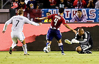 Chivas USA goalkeeper Zach Thornton readies himself for a save from advancing DC United forward Adam Cristman with help from teammate Michael Umana. CD Chivas USA beat DC United 1-0 at Home Depot Center stadium in Carson, California on Sunday August 29, 2010.