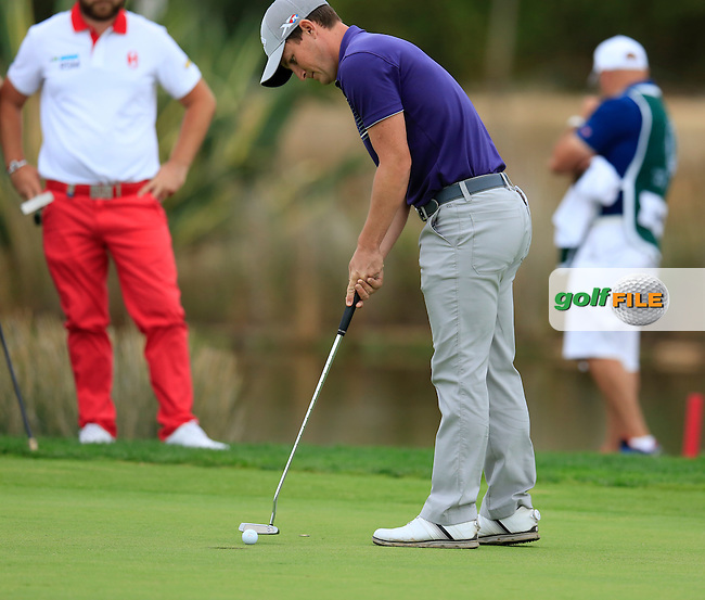 Chris Paisley (ENG) putts on the 17th green during Sunday's Final Round of the 2016 Portugal Masters held at the Oceanico Victoria Golf Course, Vilamoura, Algarve, Portugal. 23rd October 2016.<br /> Picture: Eoin Clarke | Golffile<br /> <br /> <br /> All photos usage must carry mandatory copyright credit (&copy; Golffile | Eoin Clarke)