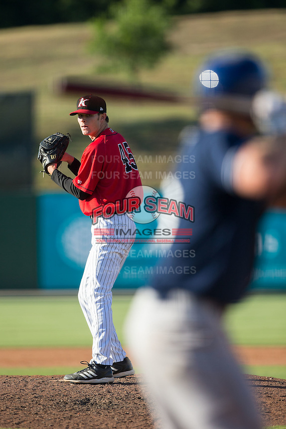 Kannapolis Intimidators relief pitcher Connor Walsh (45) looks to his catcher for the sign against the Asheville Tourists at Intimidators Stadium on June 28, 2015 in Kannapolis, North Carolina.  The Tourists defeated the Intimidators 6-4.  (Brian Westerholt/Four Seam Images)