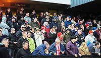 Lincoln City fans watch their team in action<br /> <br /> Photographer Andrew Vaughan/CameraSport<br /> <br /> The EFL Sky Bet League Two - Cambridge United v Lincoln City - Saturday 29th December 2018  - Abbey Stadium - Cambridge<br /> <br /> World Copyright © 2018 CameraSport. All rights reserved. 43 Linden Ave. Countesthorpe. Leicester. England. LE8 5PG - Tel: +44 (0) 116 277 4147 - admin@camerasport.com - www.camerasport.com