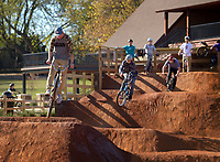 NWA Democrat-Gazette/BEN GOFF @NWABENGOFF<br /> Riders session the dirt jumps on Saturday Nov. 7, 2015 during opening day of The Railyard bike park in Rogers.