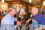 Tom O'Shea bar manager of Charlie's Bar at the Kerins O'Rahillys Clubhouse serves customers Dick Smith and Dick Donnelly, the bar is open 25years this week.