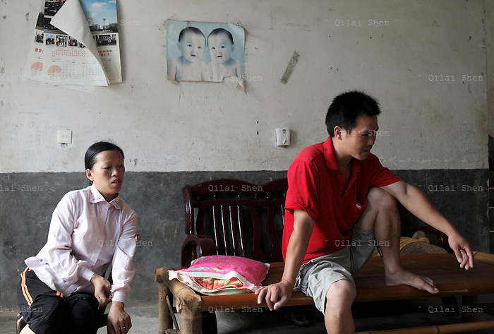 Villagers at their home near the Changsha Xianghe Chemical Factory in Shuangqiao Village, Hunan Province, China on 13 August 2009.  The chemical plant has been shut down on suspected inadequate waste treatment that may have led to water and soil contamination that caused illness and death within the village of Shuangqiao.
