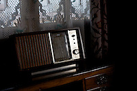 An old radio sits silently, as there are no guests to play for.