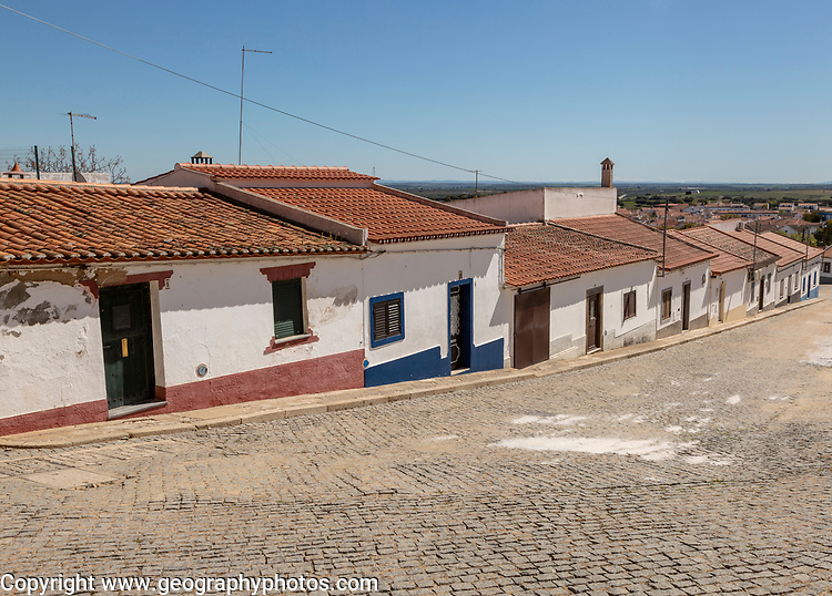 Traditional street of small Portuguese whitewashed cottage houses, Mourão , Alentejo Central, Evora district, Portugal, southern Europe