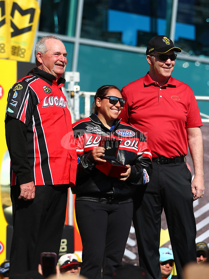 Mar 19, 2017; Gainesville , FL, USA; NHRA super gas driver Mia Tedesco receives her championship jacket and ring from NHRA president Peter Clifford during the Gatornationals at Gainesville Raceway. Mandatory Credit: Mark J. Rebilas-USA TODAY Sports