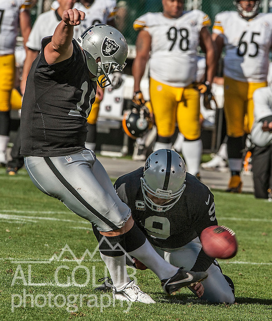 Oakland Raiders punter Shane Lechler (9) holds for kicker Sebastian Janikowski (11) who successfully kicks field goal on Sunday, September 23, 2012, in Oakland, California. The Raiders defeated the Steelers 34-31.   .