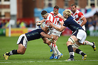 Luke Thompson of Japan is tackled. Rugby World Cup Pool B match between Scotland and Japan on September 23, 2015 at Kingsholm Stadium in Gloucester, England. Photo by: Patrick Khachfe / Onside Images