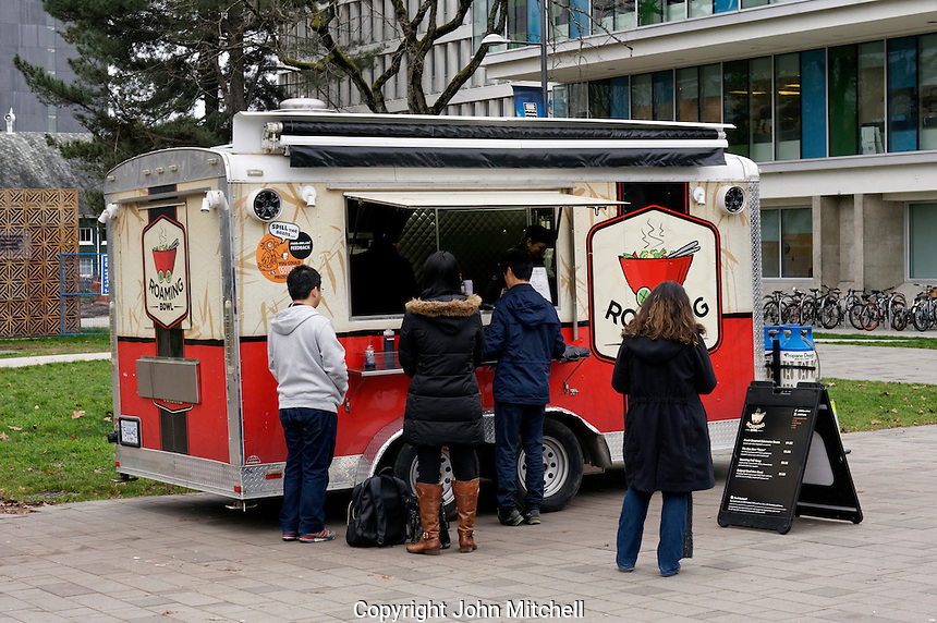 Students ordering lunch at an Asian food truck on the campus of the University of British Columbia, Vancouver, Canada