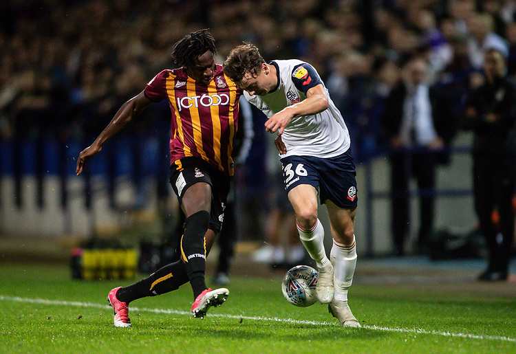 Bolton Wanderers' Callum King-Harmes (right) competing with Bradford City's Omari Patrick <br /> <br /> Photographer Andrew Kearns/CameraSport<br /> <br /> EFL Leasing.com Trophy - Northern Section - Group F - Bolton Wanderers v Bradford City -  Tuesday 3rd September 2019 - University of Bolton Stadium - Bolton<br />  <br /> World Copyright © 2018 CameraSport. All rights reserved. 43 Linden Ave. Countesthorpe. Leicester. England. LE8 5PG - Tel: +44 (0) 116 277 4147 - admin@camerasport.com - www.camerasport.com