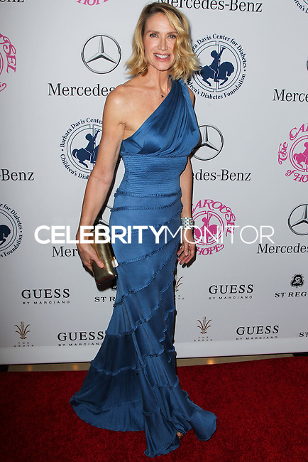 BEVERLY HILLS, CA, USA - OCTOBER 11: Kelly Lynch arrives at the 2014 Carousel Of Hope Ball held at the Beverly Hilton Hotel on October 11, 2014 in Beverly Hills, California, United States. (Photo by Celebrity Monitor)