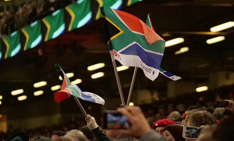 South Africa fans wave flags during the South Africa National anthem <br /> <br /> Photographer Ian Cook/CameraSport<br /> <br /> Under Armour Series Autumn Internationals - Wales v South Africa - Saturday 24th November 2018 - Principality Stadium - Cardiff<br /> <br /> World Copyright © 2018 CameraSport. All rights reserved. 43 Linden Ave. Countesthorpe. Leicester. England. LE8 5PG - Tel: +44 (0) 116 277 4147 - admin@camerasport.com - www.camerasport.com
