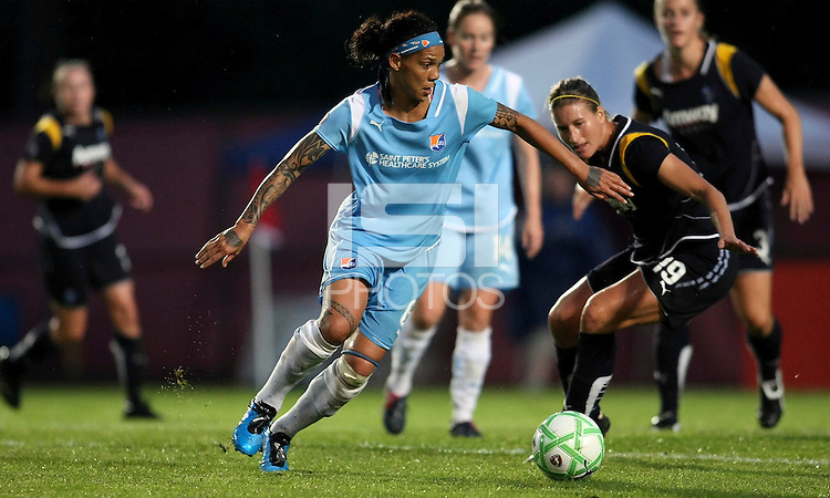 Natasha Kai (6) of Sky Blue looks for an opening against the Sol's Martina Franko (19).   Sky Blue played to a 0-0 tie against the LA Sol Saturday, June 13, in Piscataway, NJ.