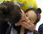 Paige Nelson gives a goodbye kiss to her daughter Gabriella Jerez, 5, who is starting her first day of kindergarten, at the Spaulding Elementary School in Suffield, this is the first year  the school is offering full day kindergarten, Tuesday, August 27, 2013. (Jim Michaud / Journal Inquirer)
