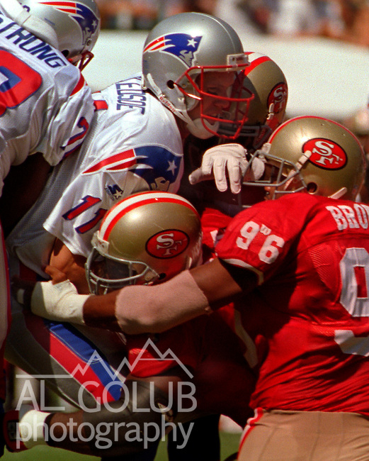 San Francisco 49ers vs. New England Patriots at Candlestick Park Sunday, September 17, 1995.  49ers beat Patriots 28-3.  San Francisco 49ers defensive tackle Bryant Young (97) and defensive end Dennis Brown (96) sacks New England Patriots quarterback Drew Bledsoe (11).