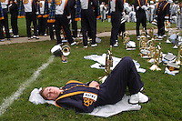Notre Dame Marching Band member Sarah Fitzpatrick takes a nap as the band waits for the football game against Michigan State University to begin on Saturday. Fitzpatrick's nap was soon interrupted by light rain..photo by Danny Gawlowski