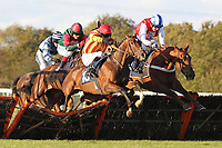 Race winner Genstone Trail ridden by Robert Thornton jumps behind Well Mett ridden by Timmy Murphy and Dancing Dude ridden by Andrew Tinkler (R) during the Ingrebourne Valley Handicap Hurdle