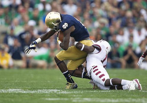 August 31, 2013:  Notre Dame wide receiver Chris Brown (2) is tackled by Temple defender during NCAA Football game action between the Notre Dame Fighting Irish and the Temple Owls at Notre Dame Stadium in South Bend, Indiana.  Notre Dame defeated Temple 28-6.