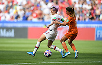 DECINES-CHARPIEU, FRANCE - JULY 07: Megan Rapinoe #15, Danielle van de Donk #10 during the 2019 FIFA Women's World Cup France Final match between Netherlands and the United States at Groupama Stadium on July 07, 2019 in Decines-Charpieu, France.
