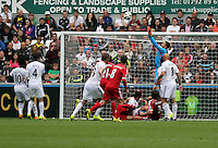 Pictured: Lukasz Fabianski of Swansea (in blue) saves the ball from a West Bromwich cross. Saturday 30 August 2014<br /> Re: Premier League, Swansea City FC v West Bromwich Albion at the Liberty Stadium, south Wales, UK
