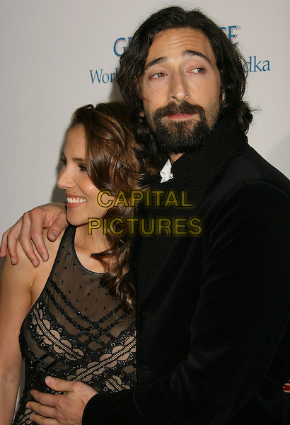 "ELSA PATAKY & ADRIEN BRODY.""Cadillac Records"" Los Angeles Premiere held at Grauman's Egyptian Theatre, Hollywood, California, USA..November 24th, 2008.half length adiran couple black suit jacket grey gray trousers dress lace sheer clutch bag beard goatee facial hair  .CAP/ADM/MJ.©Michael Jade/AdMedia/Capital Pictures."