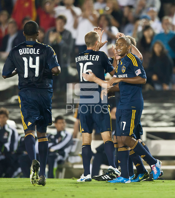 Galaxy players celebrate a goal during the first half of the friendly game between LA Galaxy and Real Madrid at the Rose Bowl in Pasadena, CA, on August 7, 2010. LA Galaxy 2, Real Madrid 3.