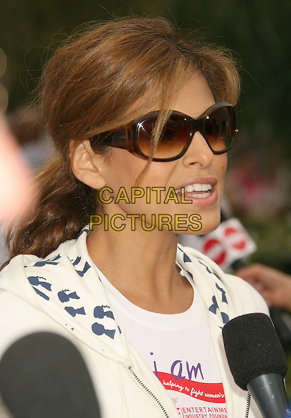 EVA MENDES.14th Annual Entertainment Industry Foundation Revlon Run/Walk For Women held at The Los Angeles Memorial Coliseum, Los Angeles, California, USA,.12 May 2007..portrait headshot sunglasses microphone interview.CAP/ADM/RE.©Russ Elliot/AdMedia/Capital Pictures.