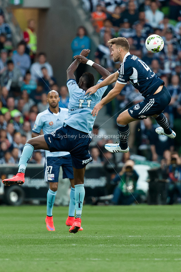 MELBOURNE, 17 May 2015 - Nicholas ANSELL (4) of the Victory and Bernie IBINI of Sydney fight for the ball in the grand final of the 2014-15 A-League match between Sydney FC and Melbourne Victory at AAMI Park in Melbourne, Australia. Victory won 3-0. Photo Sydney Low. This image is not for sale on this web site. Contact zumapress.com for licensing.