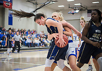 NWA Democrat-Gazette/CHARLIE KAIJO Rogers High School forward Ally Figenskau (34) reaches to steal the ball from Bentonville West High School guard Anna Kash (15) during a basketball game, Friday, February 8, 2019 at Rogers High School in Rogers.