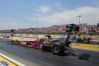 May 19, 2012; Topeka, KS, USA: NHRA top fuel dragster driver Scott Palmer (near lane) races alongside Mike Stasburg during qualifying for the Summer Nationals at Heartland Park Topeka. Mandatory Credit: Mark J. Rebilas-