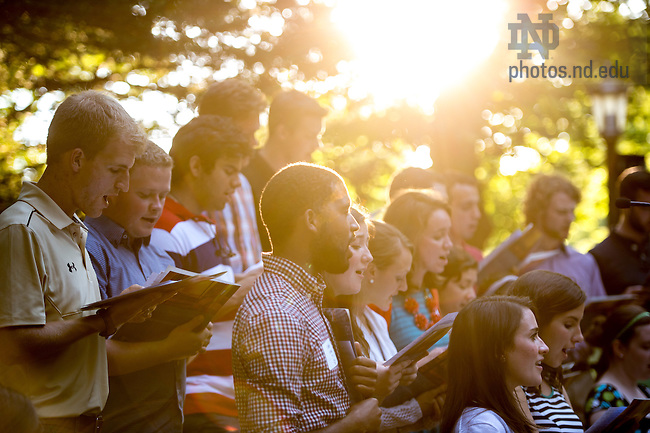 Jul. 23, 2015; The Folk Choir sings at the ACE Grotto prayer service. (Photo by Matt Cashore/University of Notre Dame)