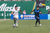 Portland, Oregon - Sunday October 6, 2019: Jorge Moreira #2 dribbles the ball while being tracked down by Valeri Qazaishvili #11 during a regular season match between Portland Timbers and San Jose Earthquakes at Providence Park in Portland, Oregon.