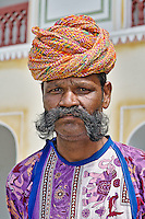 Indian man at the Raj Palace Hotel, with long mustache,  Jaipur, India