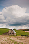 Weathered wooden barn along the road in the rolling hills of Washington's Palouse.